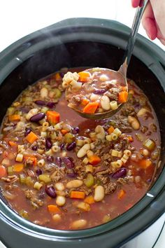 """A delicious and hearty slow cooker pasta, vegetable, and ground beef soup copycatting the famous """"Olive Garden"""" Ingredients: 1 pound extra lean ground beef, browned and drained 1 cup chopped onion 1 cup chopped carrots ½"""