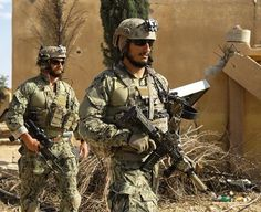 Armed men in uniform identified by Syrian Democratic forces as US special operations forces walk in the village of Fatisah in the northern Syrian province of Raqa on May US-backed Syrian. Get premium, high resolution news photos at Getty Images