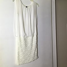 Going out off white dress! No sleeves looks like a shirt and a skirt put together the top is lose and the bottom tight. Really cute. WINDSOR Dresses