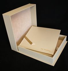 Wedding album bound in ivory shimmer leather with matching drop back box. https://www.etsy.com/uk/listing/226808054/12-x-12-luxury-leather-photo-album-with?ref=shop_home_active_1