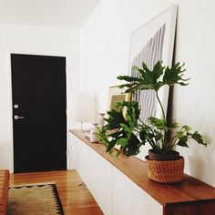 White and wood console/cabinet. Black door.