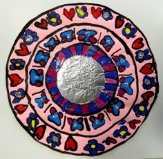 For Hispanic Heritage Month, make these Mexican Folk Art Mirrors with your kids!