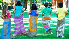 Kids in a sack race with painted sacks