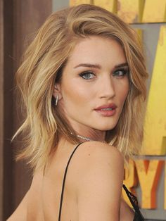 "If you're looking for something low maintenance, these golden wheat and honey blonde hues work together for a natural-looking, multi-tonal look that suits the beach. ""The key with this look is for the colorist to work with the client's natural colour on the parting,"" says Reid. ""Going lighter around the face allows for an organic texture that won't wind up looking stripe-y or over highlighted. Working a few pieces in a Foilyage technique provides a natural finish and controlled lightening…"