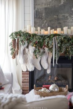 A Christmas mantel with greenery, cream stockings, twinkle lights, and the warm glow of candlelight. A Classic holiday mantel with traditional colors. holiday Christmas Home Tour Christmas Fireplace, Christmas Mantels, Farmhouse Christmas Decor, Noel Christmas, Merry Little Christmas, Rustic Christmas, All Things Christmas, Christmas Wreaths, Holiday Decor