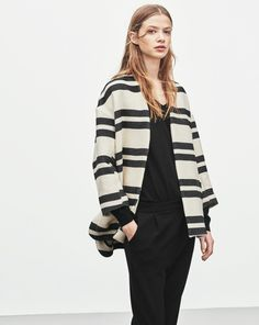 A graphic striped cardi jacket with a generous, slightly sculptural fit. Lined fabric with a luxe feel, and a contrasting rope belt. Wear open or loose or tightly belted for a more feminine look. A hybrid piece that works for indoor as outdoor dressing pe