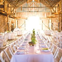 perfect elegant barn wedding, mix of long and round tables.. kinda neat.