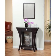 Elevate your decor with this console table featuring a beautiful cappuccino finish and lithe profile. Sporting curvy legs and a graceful stance, this demure piece lends character to your home. Use its