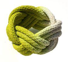 Knotted rope bracelet.   The tutorial is here:  http://www.dismountcreative.com/diy-urban-rustic-turks-head