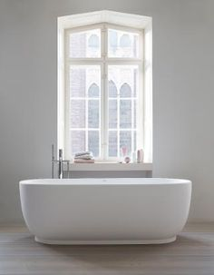 A freestanding bathtub from the Luv collection by luxury bathroom brand Duravit. Designed by Danish designer Cecilie Manz, the collection is characterised by its elegant and feminine curves. Serene Bathroom, Beautiful Bathrooms, Small Bathroom, Master Bathroom, Bathroom Sinks, Bathroom Ideas, Bad Inspiration, Bathroom Inspiration, Bidet