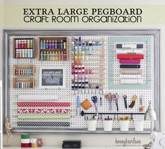 Extra Large Pegboard Craft Room Organization - I Love This Pegboard Idea + How she Put the Frame around the board as well!!! She doesn't have a designated craft room but an extra large LR so she devoted a corner of her LR for her craft area - Great idea when space is limited! Love it!! | Honeybearlane.com (04.05.13) #pegboard