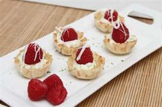 1-8oz package of cream cheese, softened     1/2 cup of powdered sugar     1 tsp lime zest     1 Tbsp of fresh lime juice     30-mini phyllo pastry shells,  thawed     30 fresh raspberries     4 ounces white chocolate, melted     Stir together cream cheese, powdered sugar, lime zest, and lime juice. Evenly spoon mixture into pastry shells. Top each with a fresh raspberry and then drizzle with white chocolate.