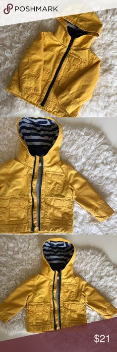 Crazy 8 Toddler Lined Fall Yellow Cotton Raincoat 6-12 Months  This adorable, yellow coat is cotton lined and has a cotton shell with hood. The pockets are real with velcro closure. It has my son's name on the tag (for daycare reasons) and is in great used condition. Worn for barely one season until he grew out of it (and it colder out!). One ink stain on the arm in the pictures, send me an offer! Crazy 8 Jackets & Coats Raincoats