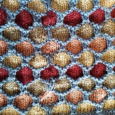 If you like playing with color combinations, you need to try this honeycomb pattern in a hat. Woolike yarn comes is several colors along with neutral colors such as gray, white and black. This uses two shades of gray to offset the pink and maroon. Try it in shades of purple or blue or orange and brown. I used four different colors for the honeycomb, but you can use only one, two, three or several colors. It also uses a banded brim for extra warm, but if you prefer, you can use a rib of 1x1…
