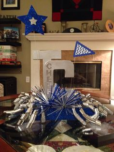 More TCHS Titan Cheer Banquet centerpieces for 2014! Sports Banquet Centerpieces, Banquet Decorations, Cheer Decorations, Banquet Ideas, Cheerleading Gifts, Cheer Coaches, Cheer Gifts, Cheer Snacks, All Star Cheer