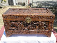 | George Zee Hand Carved Cedar Chest Trunk Antique Asian. We have this, but with a glass top that fits over the top to prevent dust collection. Very heavy. Very beautiful. Picked this up and many other rosewood furniture items while traveling to Hong Kong in the 70's.