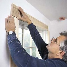 Trim a window with molding - For full step-by-step instructions, shopping lists, and tool list, see How to Trim Out a Window.