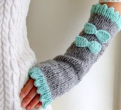 Fingerless gloves with bows hand knitted in gray and by CozySeason, $33.00