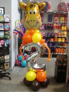 Giant 2nd birthday balloon decoration. Jungle themed party. Decoration made by Let's Celebrate Parties