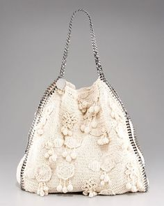 Not a crochet pattern, but this Stella McCartney Crocheted Tote comes with a price tag of US$2,165.