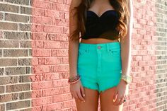 Bustier crop tops & bright high waisted shorts.