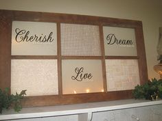 Window with vinyl lettering and scrapbook paper. Neato!