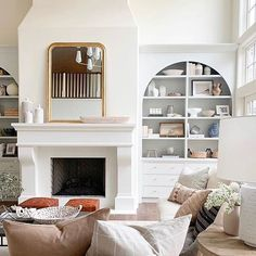 Usually I get excited about bold pattern and color but these white walls scream elegance! Im loving this living room decor .Arched built ins blush and warm colors elevate the space while providing that sense of calm. Fireplace Built Ins, Fireplace Design, Fireplace Ideas, Studio Mcgee, Coastal Living Rooms, Living Room Decor, Living Spaces, Design Studio, House Design
