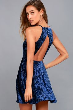 Hit the dance floor in the Dancing Queen Navy Blue Velvet Backless Skater Dress! Luxe, crushed velvet falls from a halter neckline, into a princess-seamed bodice and fitted waist. Covered button closure tops an open back design. Flirty skater skirt with hidden back zipper/clasp.