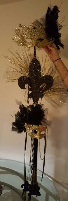 Mardi gras gold and black centerpiece