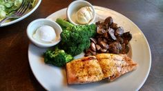 Logan's Roadhouse in Murfreesboro, TN - Beautiful #lowcarb lunch: Grilled Salmon, Steamed Broccoli & Sauteed Mushrooms with a side Caesar salad (no croutons)