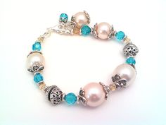 Large Pearl and aqua Swarovski crystal bracelet, Bali silver style beads, Vintage faux pearls, retro pearls, blue and pearl bracelet by barefootcreekgifts on Etsy: slightly different from the last one I made..