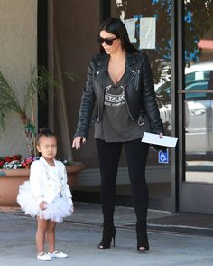 May 28, 2015 - Kim Kardashian + North West arriving at Miss Melodee Dance Studio in Woodland Hills.