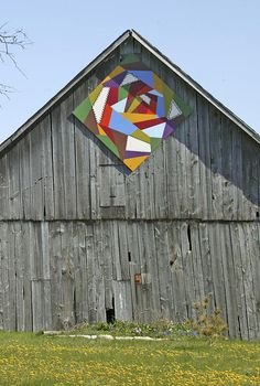 Barn Quilts. Looks like a rose