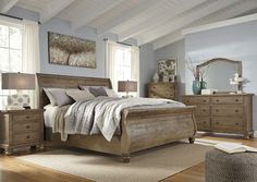 Trishley Casual Light Brown Glass Wood Master Bedroom Set
