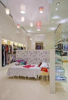 s*uce Dubai Mall fashion store, Dubai store design