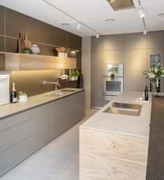 Special Olive wood veneer, bulthaup laminate in Flint, Sand Beige aluminium wall panels and Gaggenau 400 series ovens Kitchen Room Design, Modern Kitchen Design, Kitchen Interior, Kitchen Decor, Kitchen Ideas, Luxury Kitchens, Home Kitchens, Bulthaup Kitchen, Tall Kitchen Cabinets