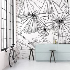 Make a statement wall in your bedroom with this black and white, funky-tropical wallpaper