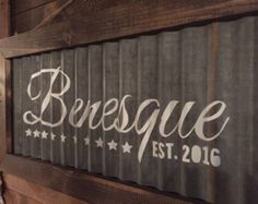 Give your home an industrial look with this customizable corrugated metal and wood last name sign. The metal is reclaimed from an old barn roof so rust amounts will vary. The wood has been stained a dark color. The sign hangs from natural twine. Your name will first be added to this design and sent to you via PDF to make sure spelling is correct. Once approved, we will create a stencil out of the design and spray paint (in white) onto the metal. To give the sign a worn/aged look, we allo...