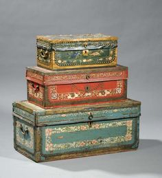 Nesting set of three 19th C Chinese camphor wood studded leather decorated boxes