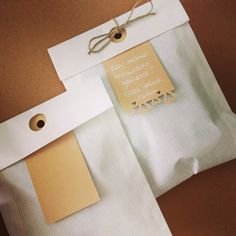 White kraft gift bag with kraft merchandise tag and white ink. Simply beautiful gift wrap. From Ik-stempel.