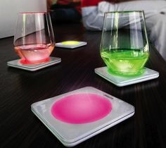 Lumiware Color Changing Coasters by Philips. The set of four decorative coasters featuring colored LED lights. Gadgets And Gizmos, Cool Gadgets, Sabre Laser, Take My Money, Luminaire Design, Philips, Coaster Furniture, Led Furniture, Cool Inventions