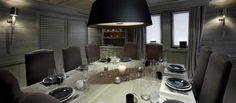 Huvila Valkoisen Helmen (Ranskan Alpit) ruokailutila on harmaa ja moderni, mutta silti lämpivän kutsuva.