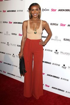 Melody Thornton looked gorgeous in a nude tank and paprika hued high waisted, wide legged pants.
