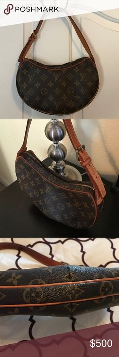 """Authentic Louis Vuitton Monogram Croissant PM This authentic Louis Vuitton Monogram Canvas Croissant PM handbag has a soft red interior has a side compartment and has enough room for all your daily purse accessories. Measurements: 10.5""""L x 7.5""""H x 2""""D with 8.5"""" adjustable strap drop. Zipper works great. Louis Vuitton Bags"""