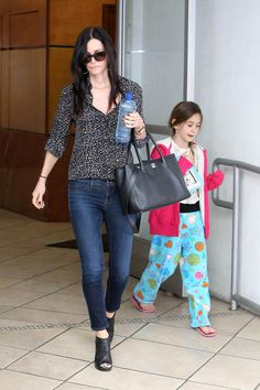 I like Courteney Cox's laid back look, she still looks put together and her hair...love it with her complexion :)