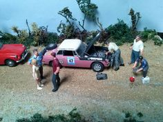 https://flic.kr/p/eMUQr1 | MGB, LONDON-SYDNEY MARATHON 1968 | MGB Mrs Jean DENTON / Mr Tom BOYCE scale 1/43 Changement de radiateur de la MGB de Jean DENTON, avec le club MGB Australia. MG Car Club President Peter Briggs talks to driver Jean Denton as co-driver and mechanic Tom Boyce fits my radiator. Standing at right is club member Pat Reid, John Keenan at the water supply canisters. The holed radiator is resting against Jean Denton's legs; it had been un-successfully repaired with…