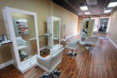 SALON TOUR: Peter David Salon in Branford, Connecticut -- white styling chairs and mirrors with hardwood floor
