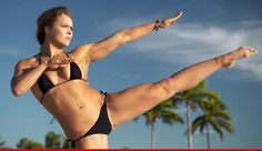 WATCH: Ronda Rousey does bikini fight workout during #SISwimsuit shoot.