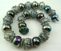Jari Ann Sheese's beads are stunning! Arrow Springs silver laden glass takes on…
