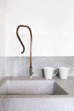 "upinteriors: "" Concrete sink with copper pipe faucet. Home of Wen Hsia and BC Ang. Photo by Marjon Hoogervorst. """